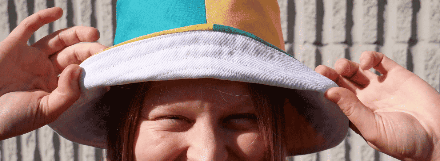 A picture containing person, headdress, hat, hand  Description automatically generated