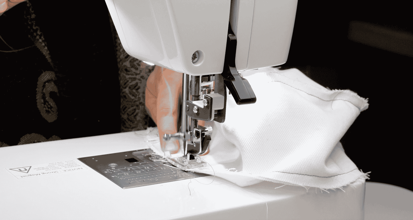 A picture containing sewing machine, appliance, indoor  Description automatically generated