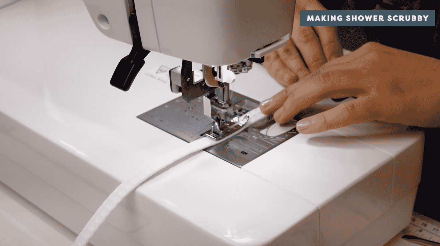 A picture containing sewing machine, appliance, indoor, person Description automatically generated