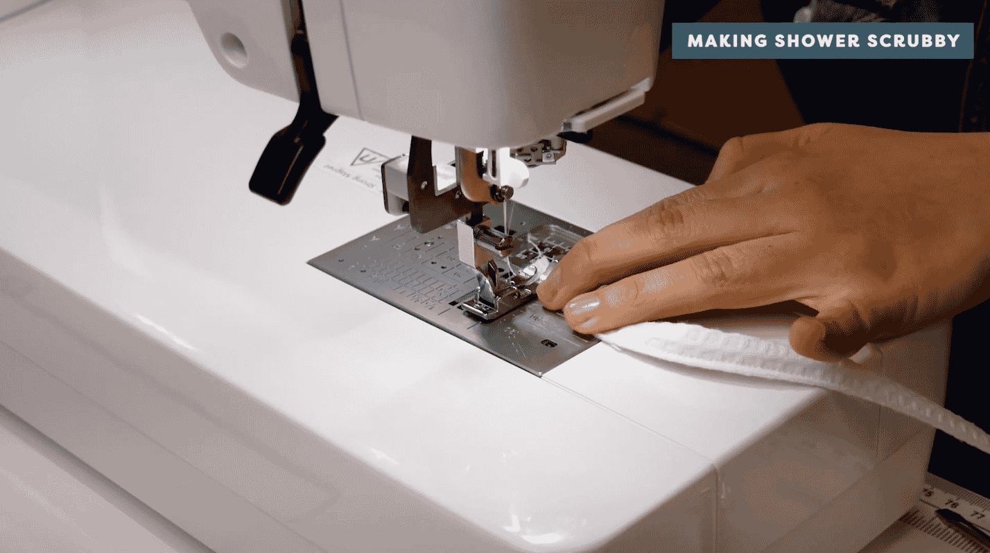 A picture containing sewing machine, appliance, person, indoor Description automatically generated
